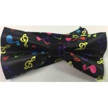 Pajarita negra con notas musicales de colores